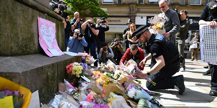 Flowers and letters of condolence laid out in a Manchester street