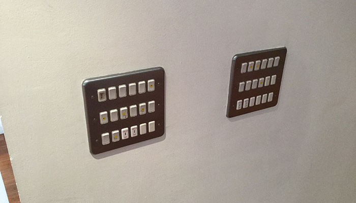 Two panels of switches on a wall