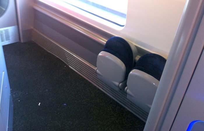 Folded seats in the Coach D corridor, on a Virgin Pendolino train