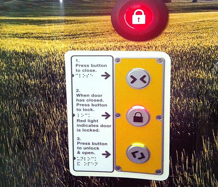 The door lock controls on a Virgin Pendolino train
