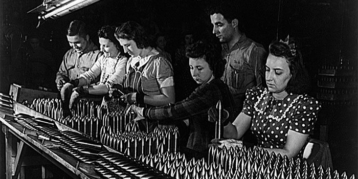 Women working in a WWII munitions factory